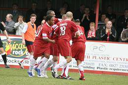 Lambs players mob Graeme Law after his penalty