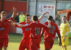 Mills is congratulated on his last minute equaliser