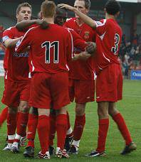 Robinson is congratulated on his equaliser