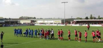 Teams shake hands before kick off