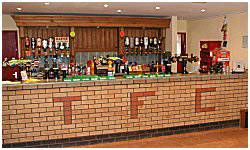 The well stocked bar in the Lamb clubhouse is open every match day